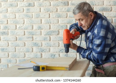 Eldery male constractor working for house or apartment renovation