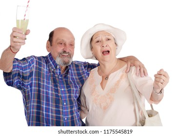 Eldery tourist couple proposing a toast. Celebration and travel concept. Isolated white background