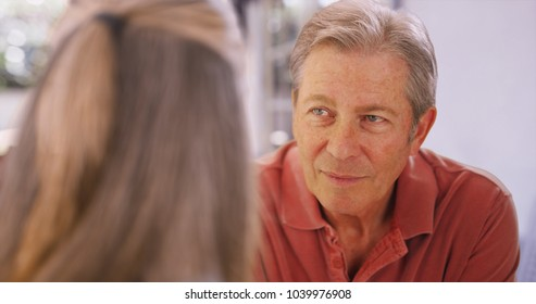 Eldery white man talking with his female companion