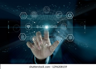 E-learning concept. Businessman touching a modern virtual interface with icon  E-LEARNING of the futuristic. Technology and network connection. Online education, e-learning business.