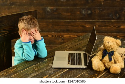Elearning concept. Little child got tired of elearning with laptop. Elearning in elementary school. Excellence through elearning. Study hard.