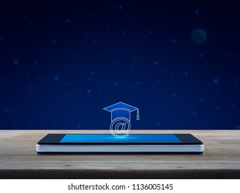 e-learning icon on modern smart phone screen on wooden table over fantasy night sky and moon, Study online concept