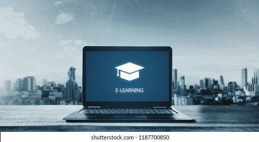 E-learning on computer laptop and city background. Online education, e-learning and e-book concept