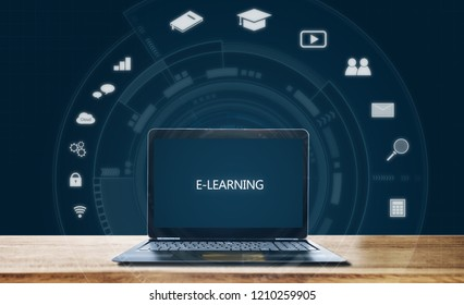 E-learning on computer laptop, on wooden table. Online education, e-learning, and education media concept
