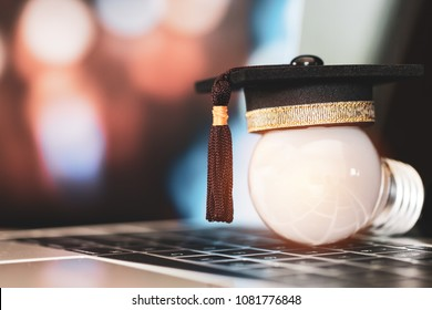 E-learning online graduate education concept : Congratulations graduates on laptop computer blur light background. Elearning can learn distant by internet enhance study