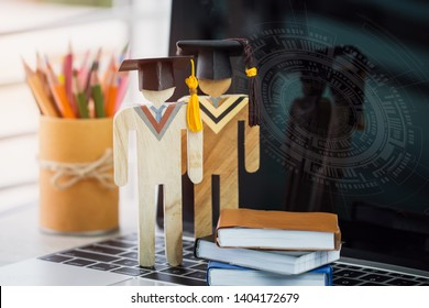 E-learning online learning of education,back to school concept, People wood graduation celebrating cap on computer screen pencil box,radar background.Alternative studying anywhere anytime for distance