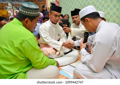 ELEBU, MALAYSIA - April 19th, 2018 : A muslim couple getting solemnization . Malay Traditional Wedding. In a islamic wedding the most important thing is the Nikah ceremony.