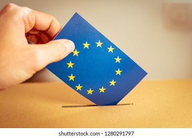 Election in European Union - voting at the ballot box. A hand putting an EU flag vote in the ballot box.