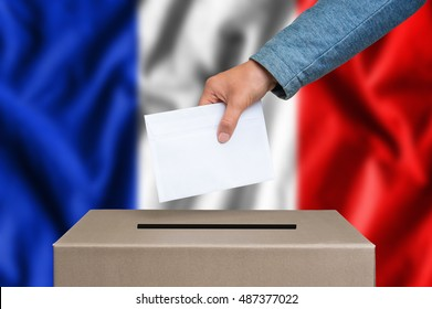 Election in France. The hand of woman putting her vote in the ballot box. French flag on background.