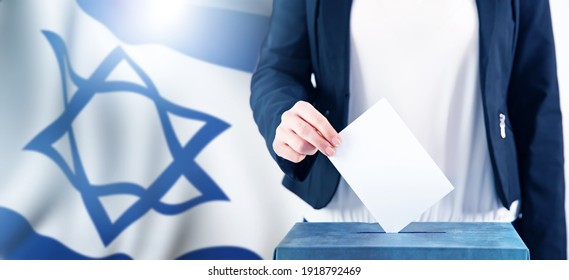 Election in Israel. Hand of a woman putting her vote in the ballot box. Waved Israel flag on background.