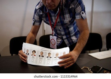 An election official holds a ballot of Turkey's presidential and parliamentary elections in Brussels, Belgium on Jun. 15, 2018