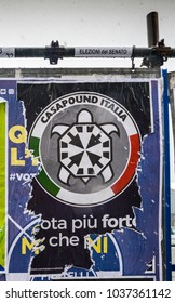 Election posters on billboard ahead of Italian General Election on March 4th, 2018 - CasaPound Italy is a neo-fascist political party founded by Gianluca Iannone