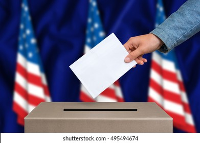 Election in United States of America. The hand of woman putting her vote in the ballot box. American flags on background.