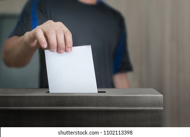 Election vote, hand holding ballot paper for election vote concept at colorful background.