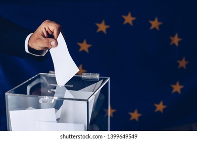 Elections to the European Parliament. EU elections. Man throwing his vote into the ballot box.
