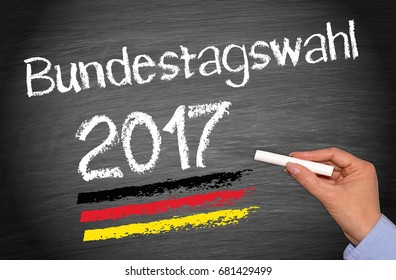 Elections in Germany 2017 - Bundestagswahl blackboard with female hand and chalk writing text