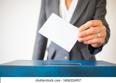 elections, The hand of woman putting her vote in the ballot box