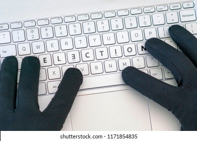 Elections inscription on laptop keyboard. Hacker man using a laptop attacks the web. Cyberattack, issues with modern elections, the hacking of accounts and leaking of information