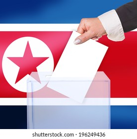 electoral vote by ballot, under the North Korea flag