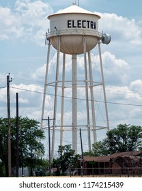 Electra, Texas / USA - July 7 2013: Multi-Column Elevated Style Water Tower with a Tin Man Style Influence.