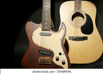 Electric and acoustic guitars on dark grey background