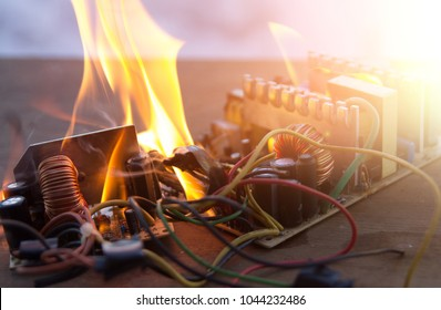 electric appliance, broken, fire, wire on fire. short circuit.