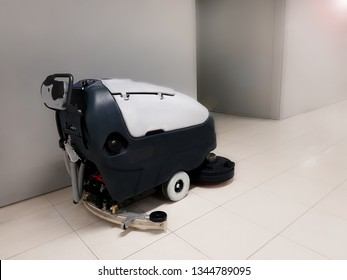 Electric automatic floor scrubber.