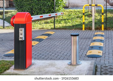 Electric barrier and speed bumps at the entrance to a parking lot