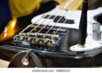 electric bass guitar in a studio closeup