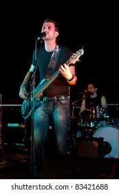 Electric bass-guitar player during a concert
