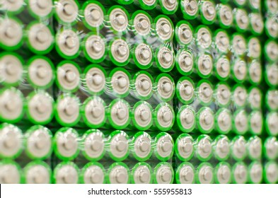 Electric batteries and accumulators size AAA AA lot of green in the package in the store. Shallow depth of field