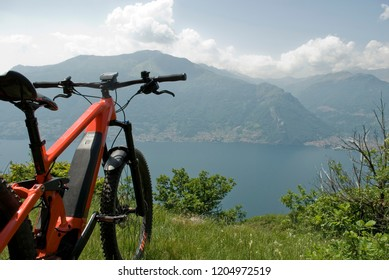 electric bicycle, e-bike, ebike (handlebar, wheels, display), mountain, valley, lake of Como, summer, sport, adventure, freedom, sun, holiday, alps, Lombardy, Italy
