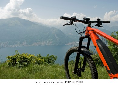 electric bicycle, e-bike, ebike, high mountains, valley, lake of Como, forest, summer, sport, adventure, cloud, sun, alps, Lombardy, technology, Italy