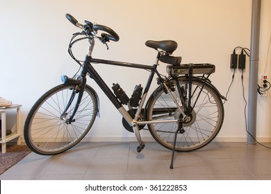 Electric bicycle in a garage, charging the battery