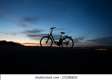 electric bicycle in sunset
