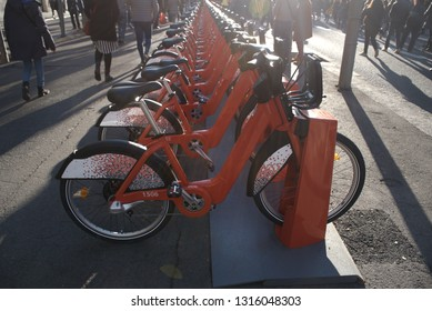Electric bicycles for rent in the middle of street. Barcelona city.