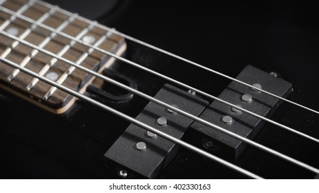 Electric Black Bass Guitar. four-stringed instrument.