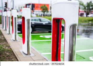 Electric Black Car charging at an Electric petrol charging station - E-Mobility