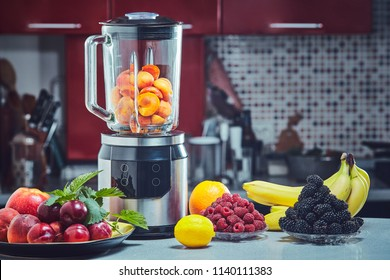 The electric blender for make fruit juice or smoothie on wooden kitchen table.