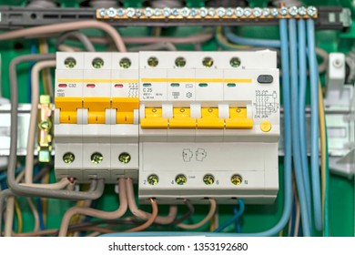 Electric board with circuit breakers. Circuit breaker used on items such as a residential iron, hot water heater, a kitchen oven, or an electric clothes dryer.