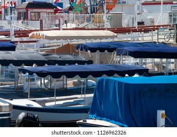 electric boat canopies at the fun zone on the Balboa Newport Beach peninsula in California