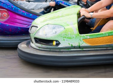Electric bumper cars in amusement park.