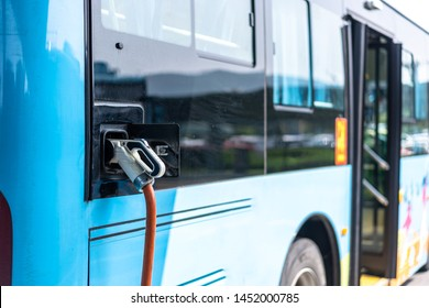 Electric bus stands at the charger