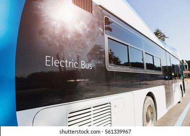 Electric bus stands at the charger. Alternative sources of fuel.