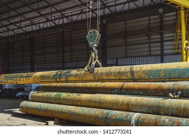 Electric Cable Hoist, heavy hoist  hook lifting of old Pipes line at warehouse