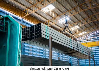 Electric Cable Hoist , heavy hoist iron hook lifting of Steel Pipes bunch and place on a truck at warehouse