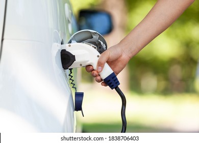 Electric car battery charging at charge station in the nature