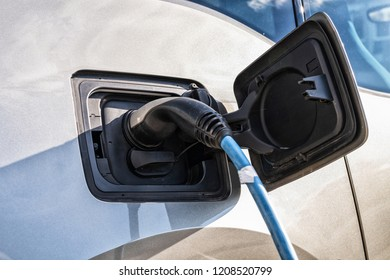 An electric car is being recharged