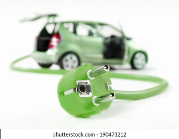 Electric car with cable and plug, all in green color and isolated on white.