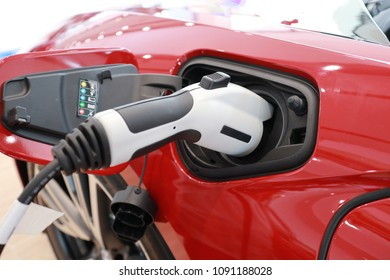 Electric car charged by plug